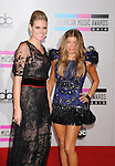 LOS ANGELES, CA. - November 21: Heidi Klum and Fergie arrive at the 2010 American Music Awards held at Nokia Theatre L.A. Live on November 21, 2010 in Los Angeles, California.