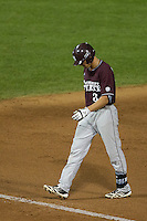 Mississippi State outfielder Hunter Renfro (34) walks off the field after making an out against the UCLA Bruins during the 2013 Men's College World Series Final on June 25, 2013 at TD Ameritrade Park in Omaha, Nebraska. The Bruins defeated the Bulldogs 8-0, winning the National Championship. (Andrew Woolley/Four Seam Images)