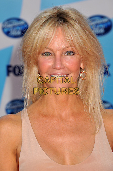 "HEATHER LOCKLEAR .""American Idol"" Season 8 Finale - Arrivals held at the Nokia Theatre LA Live,  Los Angeles, CA, USA..May 20th, 2009.headshot portrait beige pink gold hoop earrings .CAP/ADM/BP.©Byron Purvis/AdMedia/Capital Pictures."