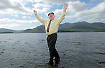 TITLE; 'All Powerfull'<br /> Jackie Healy-Rae can really walk on water. This is not a trick image as the deputy is actually walking on water....it's only three inches deep!,<br /> One of the images from Don MacMonagle's book of 100 photographs of Deputy Jackie Healy-Rae entitled 'Jackie - Keeping Up Appearance'.<br /> Picture by Don MacMonagle