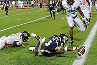 27 November 2010:  FIU's Wayne Times (5) dives to score a two-point conversation in the fourth quarter as the FIU Golden Panthers defeated the Arkansas State Red Wolves, 31-24, at FIU Stadium in Miami, Florida.