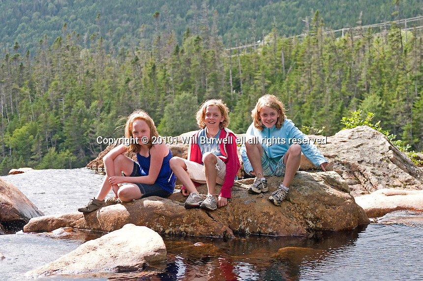 Young girls on top of Southeast Brook Falls