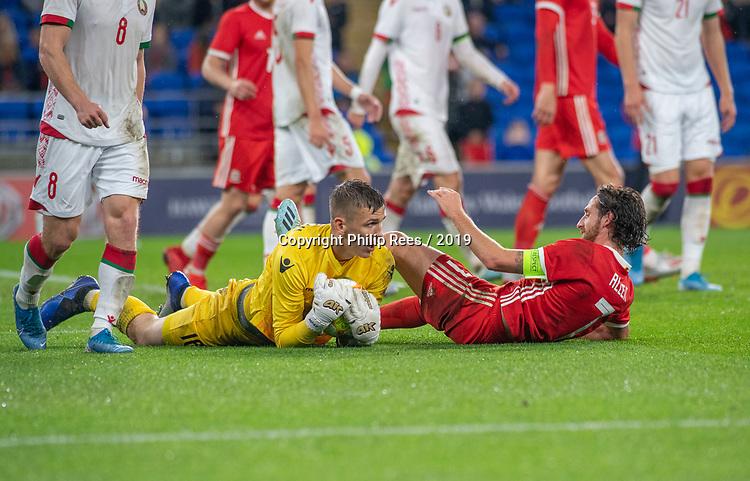 Cardiff - UK - 9th September :<br />Wales v Belarus Friendly match at Cardiff City Stadium.<br />Wales Captain Joe Allen and Belarus goalkeeper Maksim Plotnikov.<br />Editorial use only