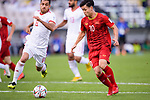 Nguyen Cong Phuong of Vietnam (R) competes for the ball with Morteza Pouraliganji of Iran (L) during the AFC Asian Cup UAE 2019 Group D match between Vietnam (VIE) and I.R. Iran (IRN) at Al Nahyan Stadium on 12 January 2019 in Abu Dhabi, United Arab Emirates. Photo by Marcio Rodrigo Machado / Power Sport Images