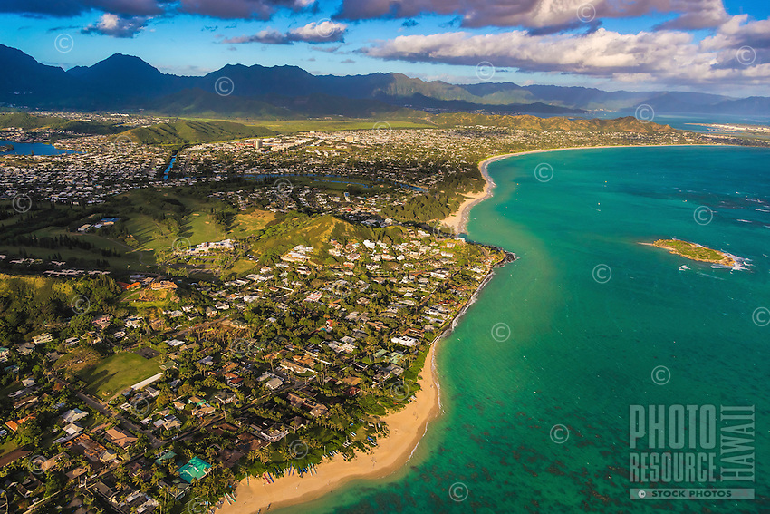 Lanikai Beach and neighborhood, with the rest of Kailua beyond, backed by the Ko'olau Mountains, Windward O'ahu; Flat Island is on the right.