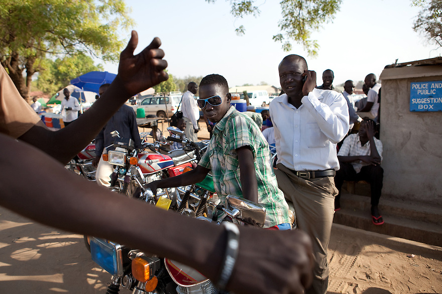 11 januay 2011 - Juba, South Sudan - Bodaboda drivers in Juba streets. Ballots are counted following a weeklong independence referendum in Juba, the capital of Southern Sudan. Photo credit: Benedicte Desrus / Sipa Press