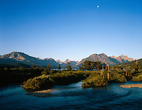 Moon over St. Mary River and mountain peaks,GLACIER NATIONAL PARK, Montana