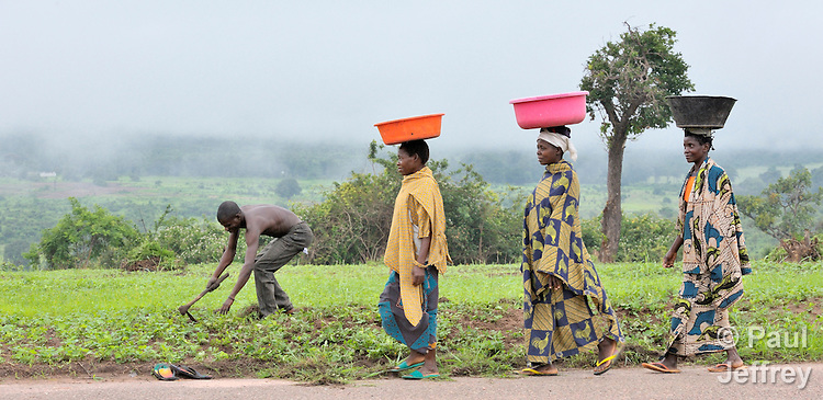 Women walk along a road on a military base near Kamina, in the Democratic Republic of the Congo.