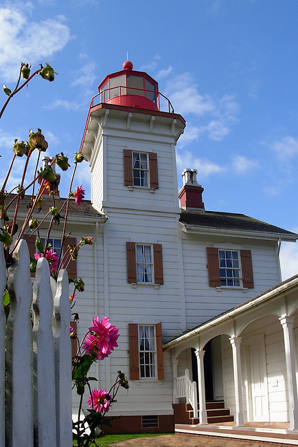 A two-story, white clapboard building with its brght red trim, the lighthouse looks more like a home. Built in 1871, the structure has been beautifully restored and maintained.