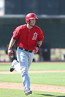 C.J. Cron #84 of the Los Angeles Angels runs the bases during a Minor League Spring Training Game against the Oakland Athletics at the Los Angeles Angels Spring Training Complex on March 17, 2014 in Tempe, Arizona. (Larry Goren/Four Seam Images)