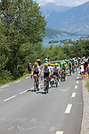 The peloton led by Team Sky start to climb Cote de Demoiselles Coiffees at Lac de Serre-Poncon during Stage 18 of the 104th edition of the Tour de France 2017, running 179.5km from Briancon to the summit of Col d'Izoard, France. 20th July 2017.<br /> Picture: Andy Brady | Cyclefile<br /> <br /> All photos usage must carry mandatory copyright credit (&copy; Cyclefile | Andy Brady)