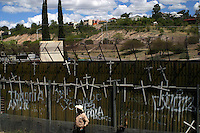 A mexican stays near the wall or fence that separates Los   Nogales, Sonora, in North Mexico, from Arizona, USA.