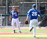 Western Nevada's Cody Hamlin makes a throw to first baseman Connor Klein in a college baseball game against Southern Nevada in Carson City, Nev., on Friday, March 22, 2013..Photo by Cathleen Allison