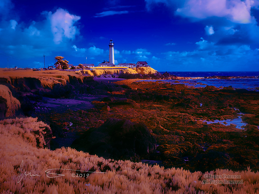 Pigeon Point Light, California (Infrared).  On a slightly blustery February afternoon with broken clouds, I waited until a beam of sunlight broke through to put a beautiful glow on this classic lighthouse.  The (false) colors of an infrared image capture the resulting splendor.<br /> <br /> Sadly, this historic structure has deteriorated so much that the public is not even allowed to go near it, let alone inside.  Let's hope that a local effort to restore it succeeds!<br /> <br /> Image © 2019 James D Peterson.