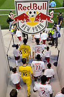Columbus Crew and New York Red Bulls players enter the field for pre-game introductions. The Columbus Crew defeated the New York Red Bulls 3-1 during a Major League Soccer (MLS) match at Red Bull Arena in Harrison, NJ, on May 20, 2010.