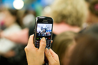 Taking mobile phone photos at the annual X-Foto competition in the Hair & Beauty Department at Kingston College, London.