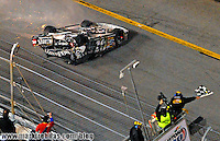 Feb 18, 2007; Daytona, FL, USA; Nascar Nextel Cup Series driver Clint Bowyer (07) slides upside down towards the checkered flag in a last lap crash during the Daytona 500 at Daytona International Speedway. Mandatory Credit: Mark J. Rebilas-US PRESSWIRE Copyright © 2007 Mark J. Rebilas..