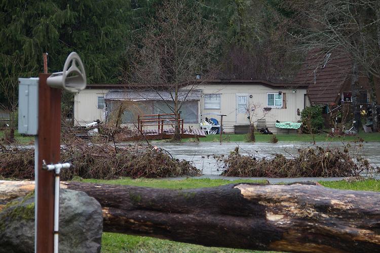 Duckabush River, Jefferson County, Olympic Peninsula, Washington State, Heavy winter rain in the Olympic Mountains causes neighborhood flooding along the Duckabush River, December 11, 2014,