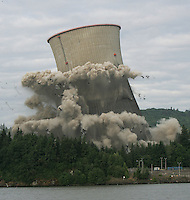 The 499-foot cooling tower at the Trojan Nuclear Plant in Rainier, Oregon is imploded on May 21, 2006.  Portland General Electric's facility located 42 miles North of Portland on the Columbia River is the first large-scale commercial nuclear plant to be decommissioned in the United States.  The implosion of the 41,000 tons of concrete and steel took only 10 seconds and 2,800 pounds of dynamite.  The tower provided water cooling for electricity production in the region from 1976-1993.  REUTERS/Steve Dipaola
