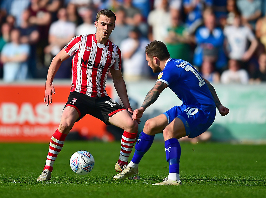 Lincoln City's Harry Toffolo vies for possession with Tranmere Rovers' James Norwood<br /> <br /> Photographer Andrew Vaughan/CameraSport<br /> <br /> The EFL Sky Bet League Two - Lincoln City v Tranmere Rovers - Monday 22nd April 2019 - Sincil Bank - Lincoln<br /> <br /> World Copyright © 2019 CameraSport. All rights reserved. 43 Linden Ave. Countesthorpe. Leicester. England. LE8 5PG - Tel: +44 (0) 116 277 4147 - admin@camerasport.com - www.camerasport.com