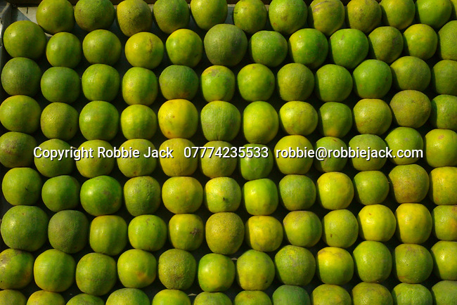 Limes on a fruit stand in the Paharganj district of New Delhi, India.