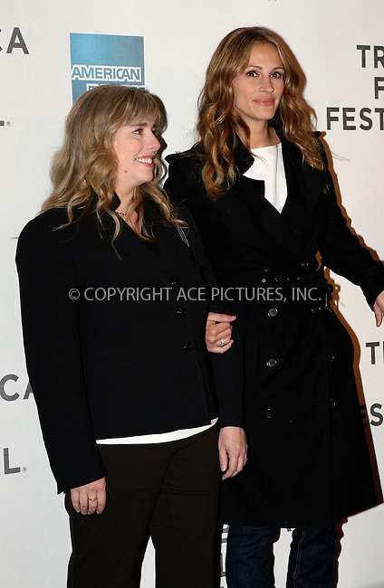 WWW.ACEPIXS.COM . . . . .  ....April 23 2011, New York City....Lisa Roberts Gillan and Julia Roberts arriving at the premiere of 'Jesus Henry Christ' during the 2011 Tribeca Film Festival at BMCC Tribeca PAC on April 23, 2011 in New York City.....Please byline: NANCY RIVERA- ACEPIXS.COM.... *** ***..Ace Pictures, Inc:  ..Tel: 646 769 0430..e-mail: info@acepixs.com..web: http://www.acepixs.com