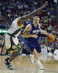 Dallas Mavericks' Dirk Nowitzki (R) drives to the basket against Seattle SuperSonics' Jerome James (L) in the first period of their game at the Key Arena in Seattle, Washington Wednesday, 13 April  2005.  Jim Bryant Photo. ©2010. All Rights Reserved.