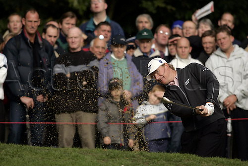 17 October 2004: South African golfer ERNIE ELS (RSA) plays from a bunker during the final of the HSBC World Matchplay Championships played at Wentworth, Surrey. Els beat Lee Westwood 2 and 1 in the final. Els has now won the title a record six times. Photo: Glyn Kirk/Action Plus...041017 golf  player sand trap bunkers