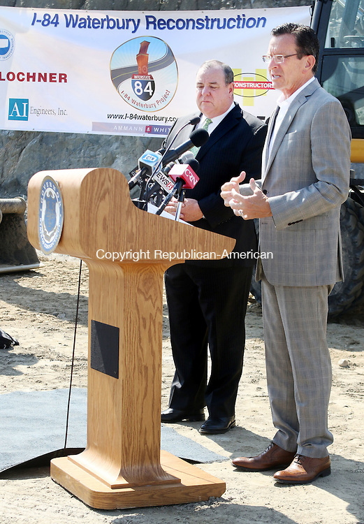 WATERBURY CT. 26 August 2016-082616SV06-From left, Mayor Neil O&rsquo;Leary listens to Gov. Dannel P. Malloy as he spoke at the Interstate 84 construction site in Waterbury Friday.<br /> Steven Valenti Republican-American