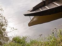 Old wooden rowing boat moored in the Dordogne, Frnace