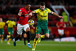 Anthony Martial of Manchester United and Grant Hanley of Norwich City battle for the ball during the Premier League match at Old Trafford, Manchester. Picture date: 11th January 2020. Picture credit should read: James Wilson/Sportimage