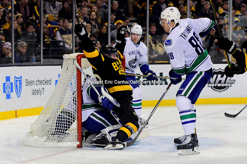 February 11, 2017: Boston Bruins center Frank Vatrano (72) falls backwards into Vancouver Canucks goalie Ryan Miller (30) during the National Hockey League game between the Vancouver Canucks and the Boston Bruins held at TD Garden, in Boston, Mass. Boston defeats Vancouver 4-3 in regulation time. Eric Canha/CSM