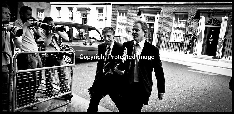 Prime Minister Tony Blair  and hus adviser  Keith Hill leave Downing st for Prime Minister's questions PRESS ASSOCIATION Photo. Picture date:Wednesday 12th July  , 2006. Photo credit should read: Andrew Parsons/PA.