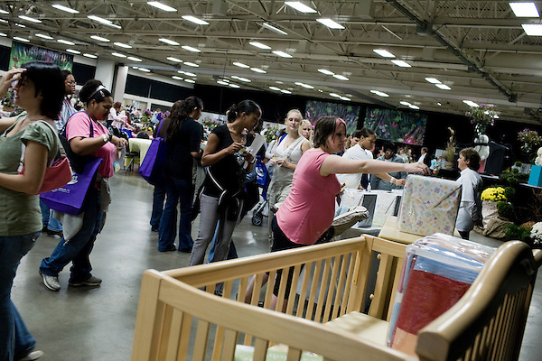 November 15, 2008. Fayetteville, NC..One thousand Army wives and active duty soldiers pregnant with what the locals call ?surge babies? were celebrated at the biggest military baby shower ever. These babies were conceived when.troops from the 82nd Airborne Division, deployed to Iraq for the surge of forces in January 2007, began returning home to Fort Bragg in November.. Attendees placed tickets in boxes for many items to be raffled off, including a Chevy Malibu.