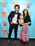 Damon J. Gillespie & Fiancee Grace Aki attends the 'Avenue Q' - 15th Anniversary Performance Celebration at Novotel on July 31, 2018 in New York City.