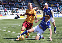 Andy McCarthy tackling James Scott in the SPFL Betfred League Cup group match between Queen of the South and Motherwell at Palmerston Park, Dumfries on 13.7.19.