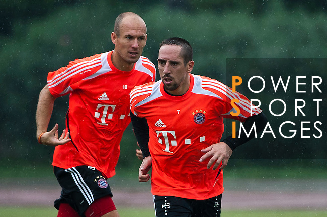 GUANGZHOU, GUANGDONG - JULY 26:  Arjen Robben and Franck Ribery of Bayern Munich during a training session ahead the friendly match against VfL Wolfsburg as part of the Audi Football Summit 2012 on July 26, 2012 at the Tianhe Sports Stadium in Guangzhou, China. Photo by Victor Fraile / The Power of Sport Images