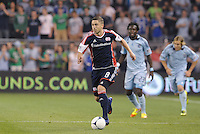 Chris Tierney (8) New England defender in action... Sporting Kansas City defeated New England Revolution 3-0 at LIVESTRONG Sporting Park, Kansas City, Kansas.