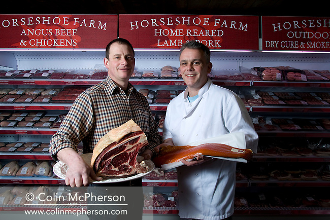 Farmer Andy Morrison and business partner Duncan Poyser, pictured in the shop at Horseshoe Farm, Alderley Edge, Cheshire. The farm has its own bakery, butchery and smokehouse and is included in one of the newly-established Cheshire Food Trails.