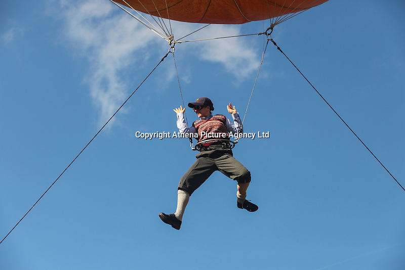 2016 09 18<br /> Pictured: Performer suspended from a giant peach. The Great Pyjama Picnic, Bute Park, Cardiff.Sunday 18 September 2016<br /> Re: Roald Dahl&rsquo;s City of the Unexpected has transformed Cardiff City Centre into a landmark celebration of Wales&rsquo; foremost storyteller, Roald Dahl, in the year which celebrates his centenary.