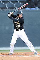 Designated hitter Mack Nathanson (34) of the Wofford College Terriers bats in a game against the Boston College Eagles on Friday, February 13, 2015, at Russell C. King Field in Spartanburg, South Carolina. Wofford won, 8-4. (Tom Priddy/Four Seam Images)