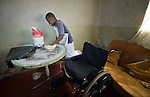 Caroline Mandishona prepares pastries to bake in her home in Bulawayo, Zimbabwe. Mandishona suffered cerebral palsy and uses a wheelchair provided by the Jairos Jiri Association with support from CBM-US.