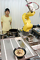 NAGOYA - SEPTEMBER 3, 2009: Aisei, an industrial robot maker in Nagoya opens Fa-men, a noodle shop where two robot arms work as hi-tech chefs that feed and entertain customers. Jun Yabe, the manager of the noodle shop poses with the robot for photograph. (Photo Laurent Benchana/Nippon News).