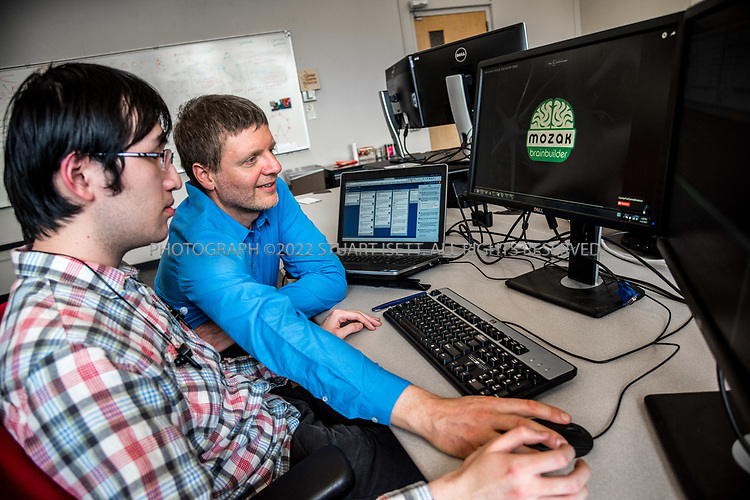 4/19/2017&mdash; Seattle, WA, USA<br /> <br /> University of Washington professor, Zoran Popovic, in his lab where students and developers are helping him build the videogame Mozak. <br /> <br /> Here: Popovic (right) works with University of Washington graduate student Zuoming Shi, 24, working on the Mozak project.<br /> <br /> The game has been created by a team at the University of Washington in Seattle led by professor Popovic and uses the skills of novice players to model brain cells with a much higher degree of accuracy than conventional computer-based modeling tools. Mozak is first collaborating with the Allen Institute for Brain Science in Seattle on the effort, but there will eventually be other participants from academia that use Mozak. <br /> <br /> Photograph by Stuart Isett. &copy;2017 Stuart Isett. All rights reserved.