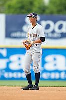 Charleston RiverDogs second baseman Gosuke Katoh (4) on defense against the Hickory Crawdads at L.P. Frans Stadium on May 25, 2014 in Hickory, North Carolina.  The RiverDogs defeated the Crawdads 17-10.  (Brian Westerholt/Four Seam Images)