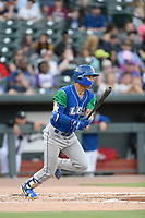 Shortstop Jeison Guzman (7) of the Lexington Legends bats in a game against Columbia Fireflies on Thursday, June 13, 2019, at Segra Park in Columbia, South Carolina. Lexington won, 10-5. (Tom Priddy/Four Seam Images)