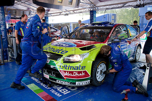 JYVASKYLA, FINLAND - JULY 29: Mechanics of BP Ford Abu Dhabi-team working on Mikko Hirvonen's of Finland car on pit area of the WRC Rally Finland on July 29, 2010 in Jyvaskyla, Finland.