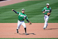 Dayton Dragons third baseman Seth Mejias-Brean #21 throws to first as Zach Vincej #4 backs up the play during a game against the Bowling Green Hot Rods on April 21, 2013 at Fifth Third Field in Dayton, Ohio.  Bowling Green defeated Dayton 7-5.  (Mike Janes/Four Seam Images)