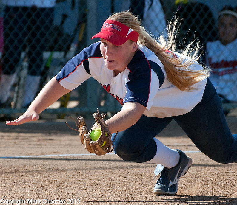 Yorba Linda High School Softball player makes a diving catch.