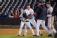 Tampa Yankees second baseman Nick Solak (39) is mobbed by teammates, including Mandy Alvarez (34), after a walk off base hit during a game against the Fort Myers Miracle on April 12, 2017 at George M. Steinbrenner Field in Tampa, Florida.  Tampa defeated Fort Myers 3-2.  (Mike Janes/Four Seam Images)